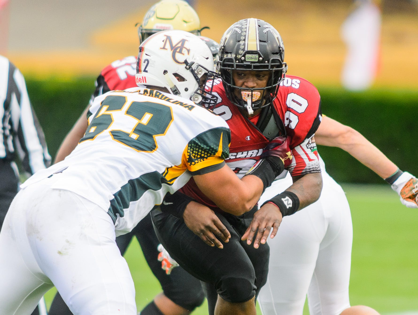 T.L. Hanna defensive lineman Zacch Pickens (90) tries the get around a blocker during the 82nd annual Shrine Bowl of the Carolinas on Saturday, December 15, 2018 at Wofford's Gibbs Stadium in Spartanburg, SC.