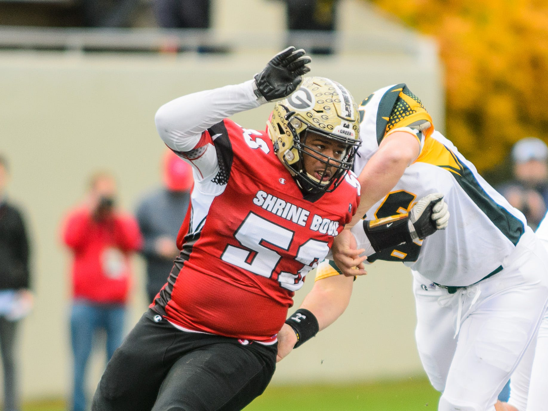 Greer defensive lineman Quack Cohen (53) rushes the quarterback during the 82nd annual Shrine Bowl of the Carolinas on Saturday, December 15, 2018 at Wofford's Gibbs Stadium in Spartanburg, SC.