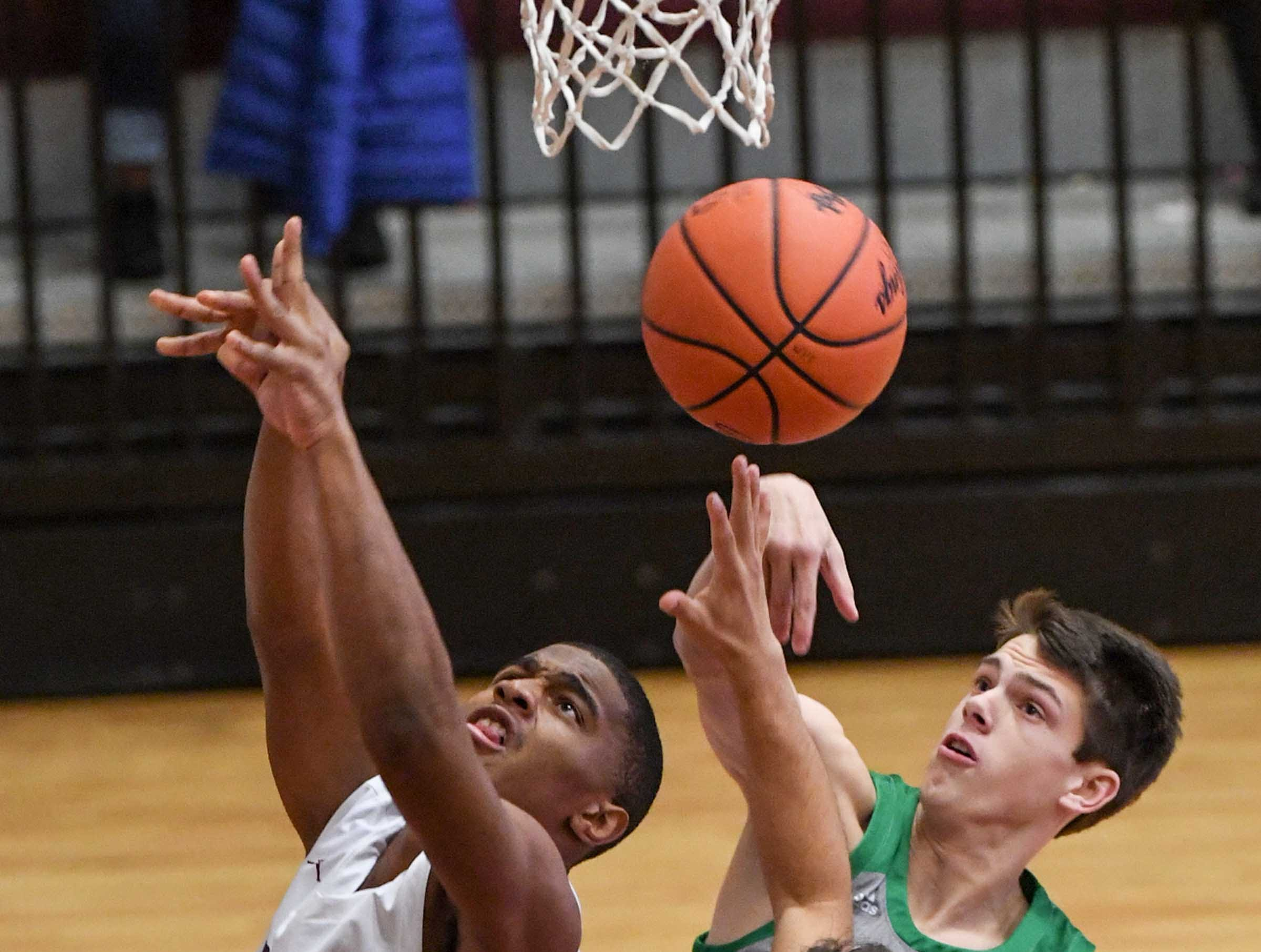 Westside senior Paul Johnson(23) and Easley senior Tanner Leisten(23) reach for a ball during the first quarter at Westside High School in Anderson on Friday.