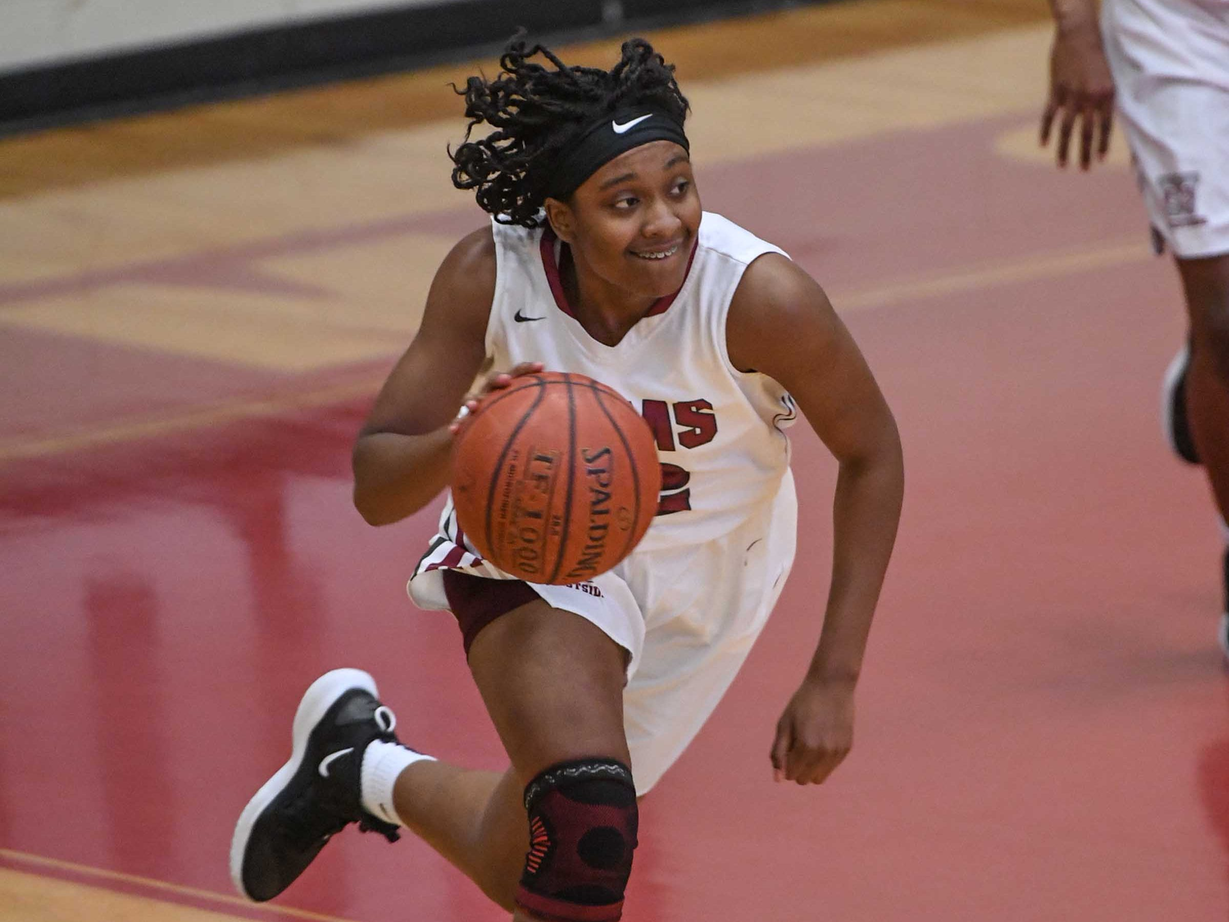 Westside freshman Branya Pruitt(12) dribbles against Easley during the fourth quarter at Westside High School in Anderson on Friday.
