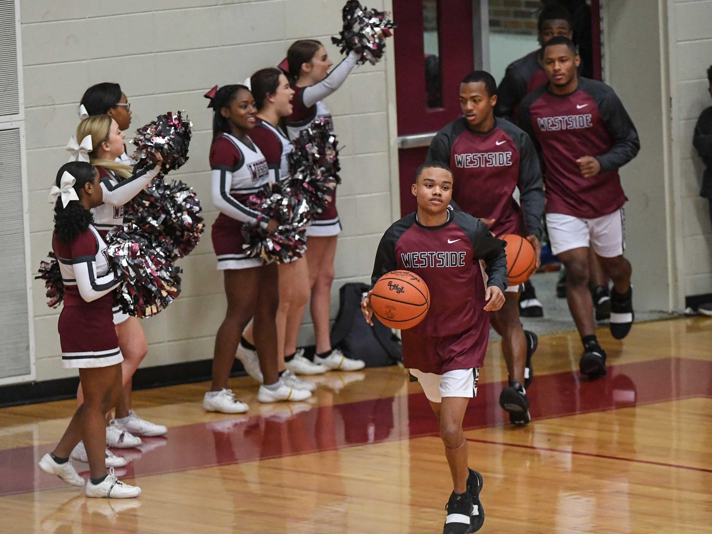 Westside senior Odarius Cade(2) leads teammates on the floor before the game with Easley High School at Westside High School Friday, December 14, 2018.