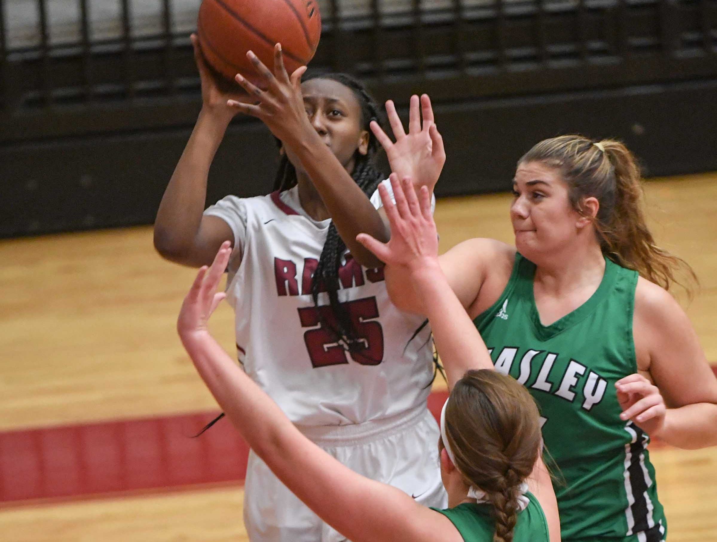 Westside junior Keyshuna Fair(25) shoots near Easley freshman Kylie Nabors(15) during the fourth quarter at Westside High School in Anderson on Friday.