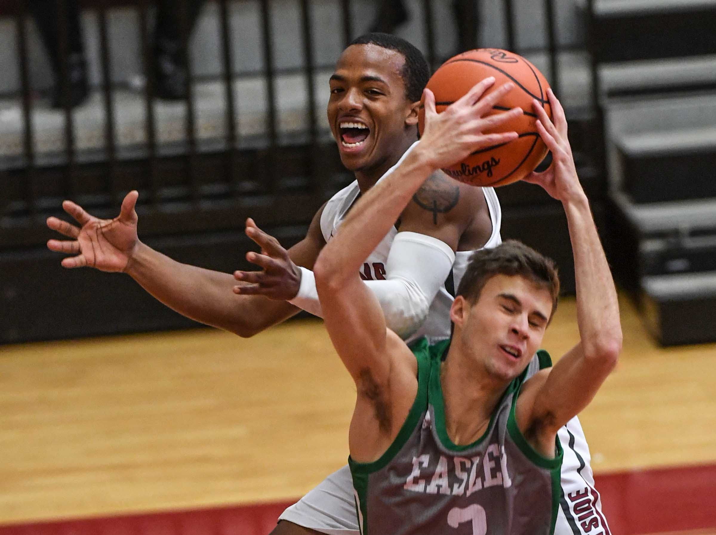 Westside senior Traye Carson(3) watches Easley senior Griffin Smith(3) rebound near him during the first quarter at Westside High School in Anderson on Friday.