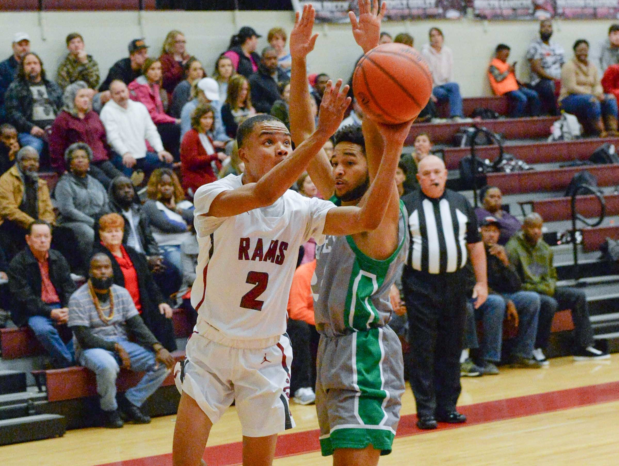 Westside senior Odarius Cade(2) shoots during the first quarter at Westside High School in Anderson on Friday.
