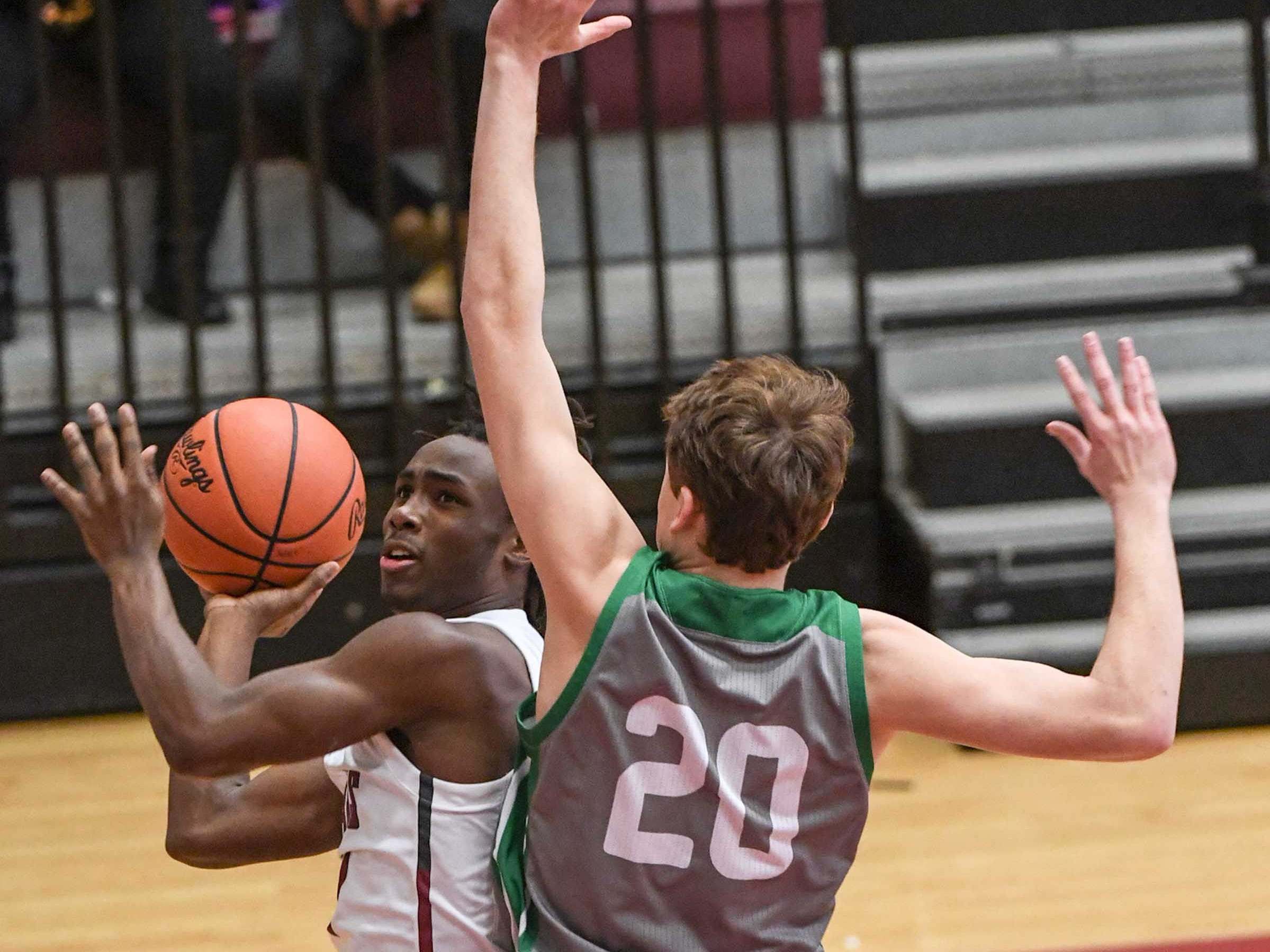 Westside junior Tyson Lewis(1) shoots near Easley senior Matt Nunnery(20) during the first quarter at Westside High School in Anderson on Friday.