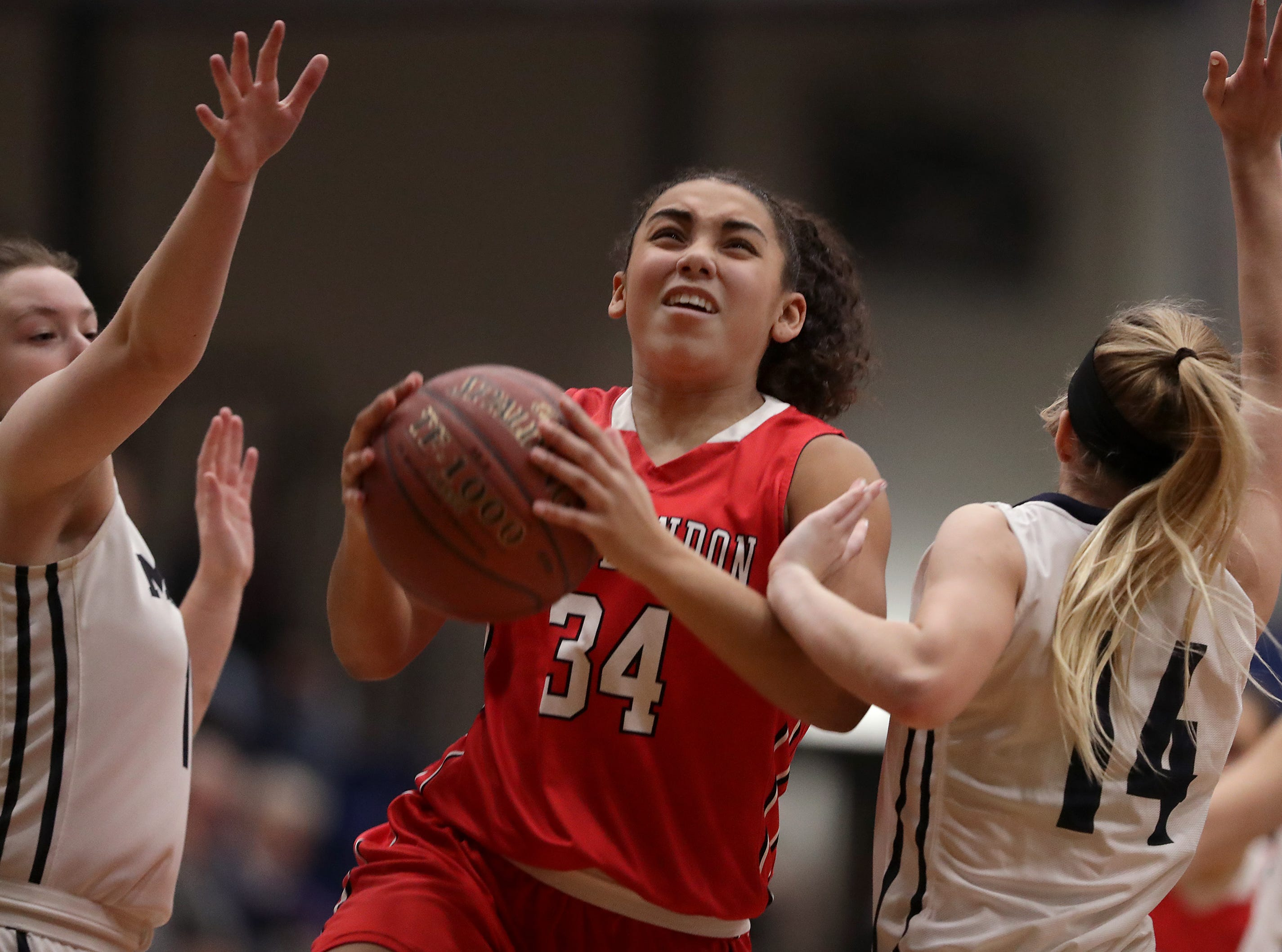 New London High School's #34 Mikayla Henderson against Menasha High School during their girls basketball game on Friday, December 14, 2018, in Menasha, Wis.