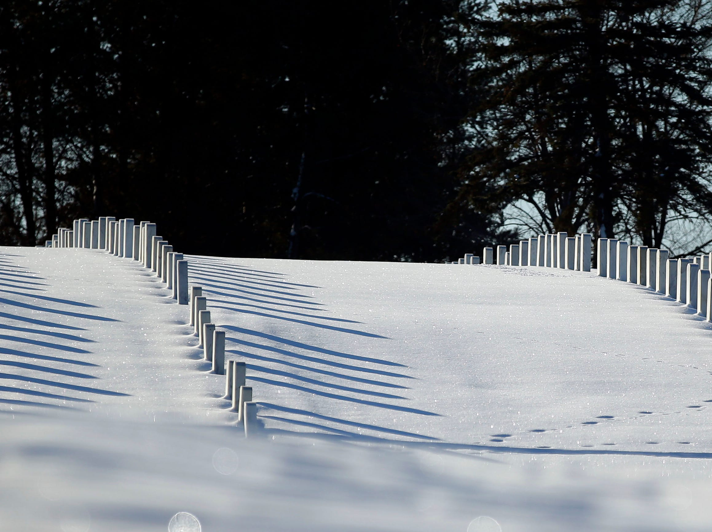 Snow surrounds headstones before volunteers take part in Wreaths Across America Day at the Central Wisconsin Veterans Memorial Cemetery Saturday, December 15, 2018, in King, Wis. Over 7000 graves at King were honored with wreaths. Over 1400 other locations took part in the coordinated ceremony.
