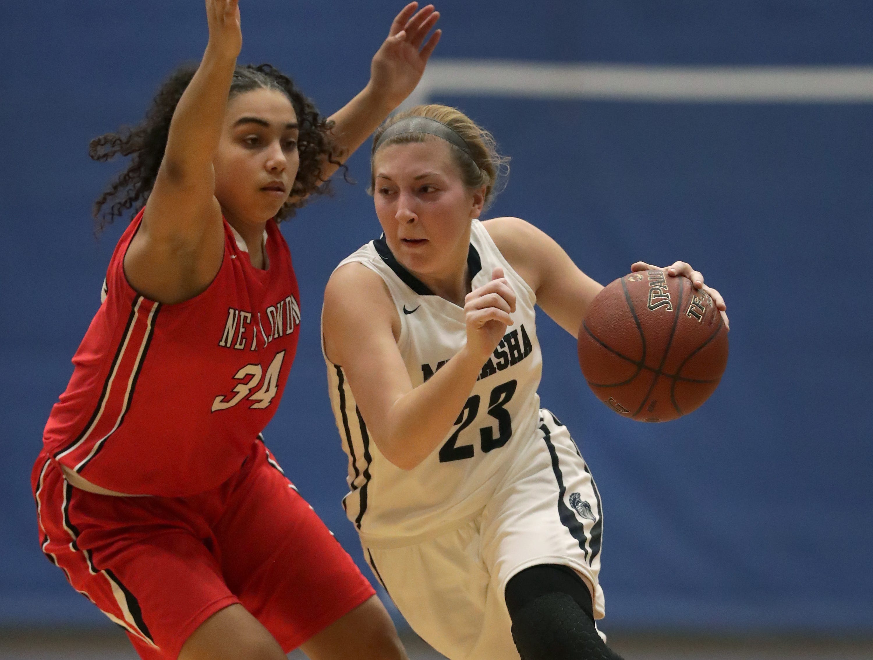 New London High School's #34 Mikayla Henderson against Menasha High School's #23 Alexa Yost during their girls basketball game on Friday, December 14, 2018, in Menasha, Wis.