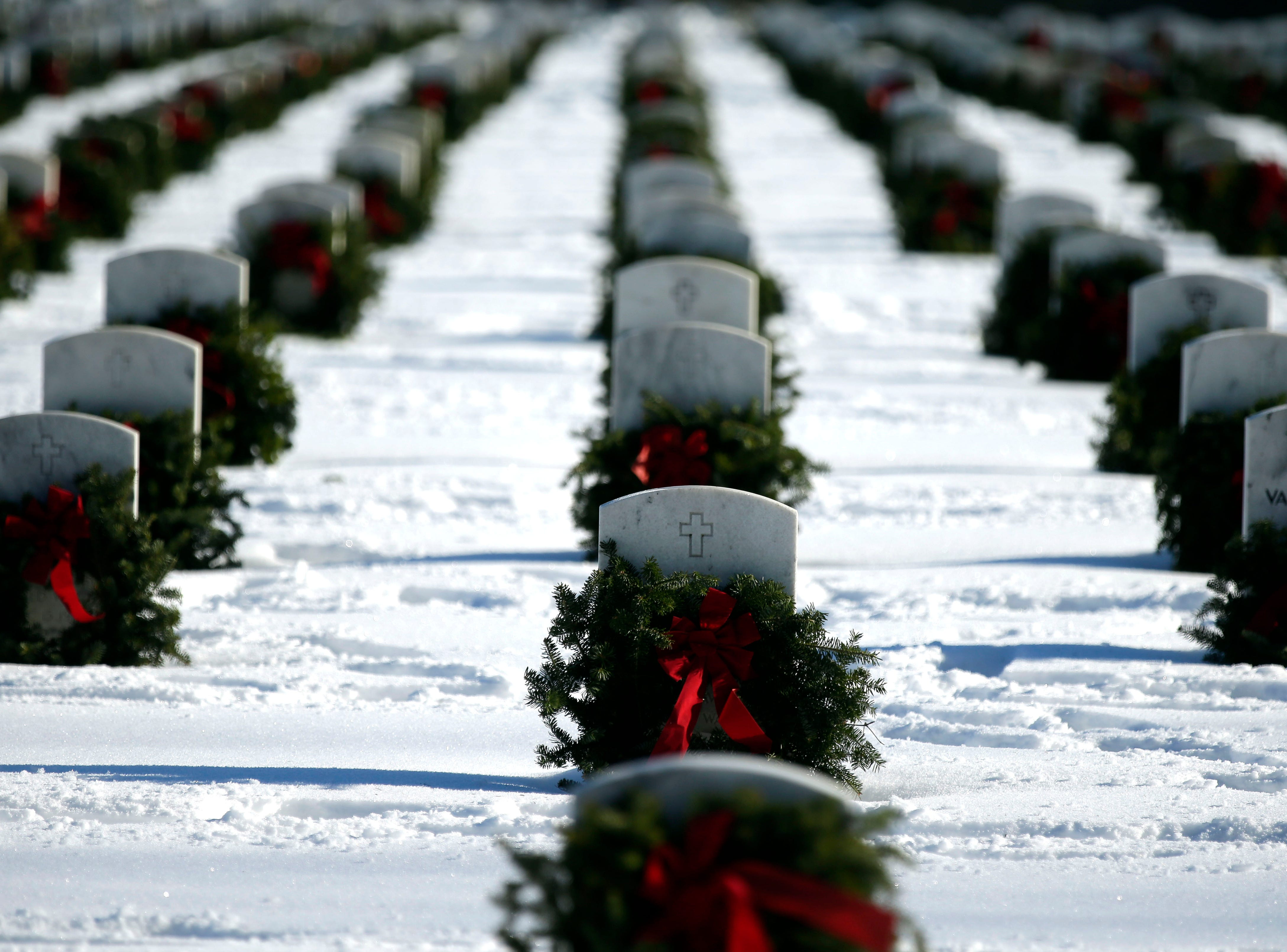Wreaths decorate headstones as part of Wreaths Across America Day at the Central Wisconsin Veterans Memorial Cemetery Saturday, December 15, 2018, in King, Wis. Over 7000 graves at King were honored with wreaths. Over 1400 other locations took part in the coordinated ceremony.