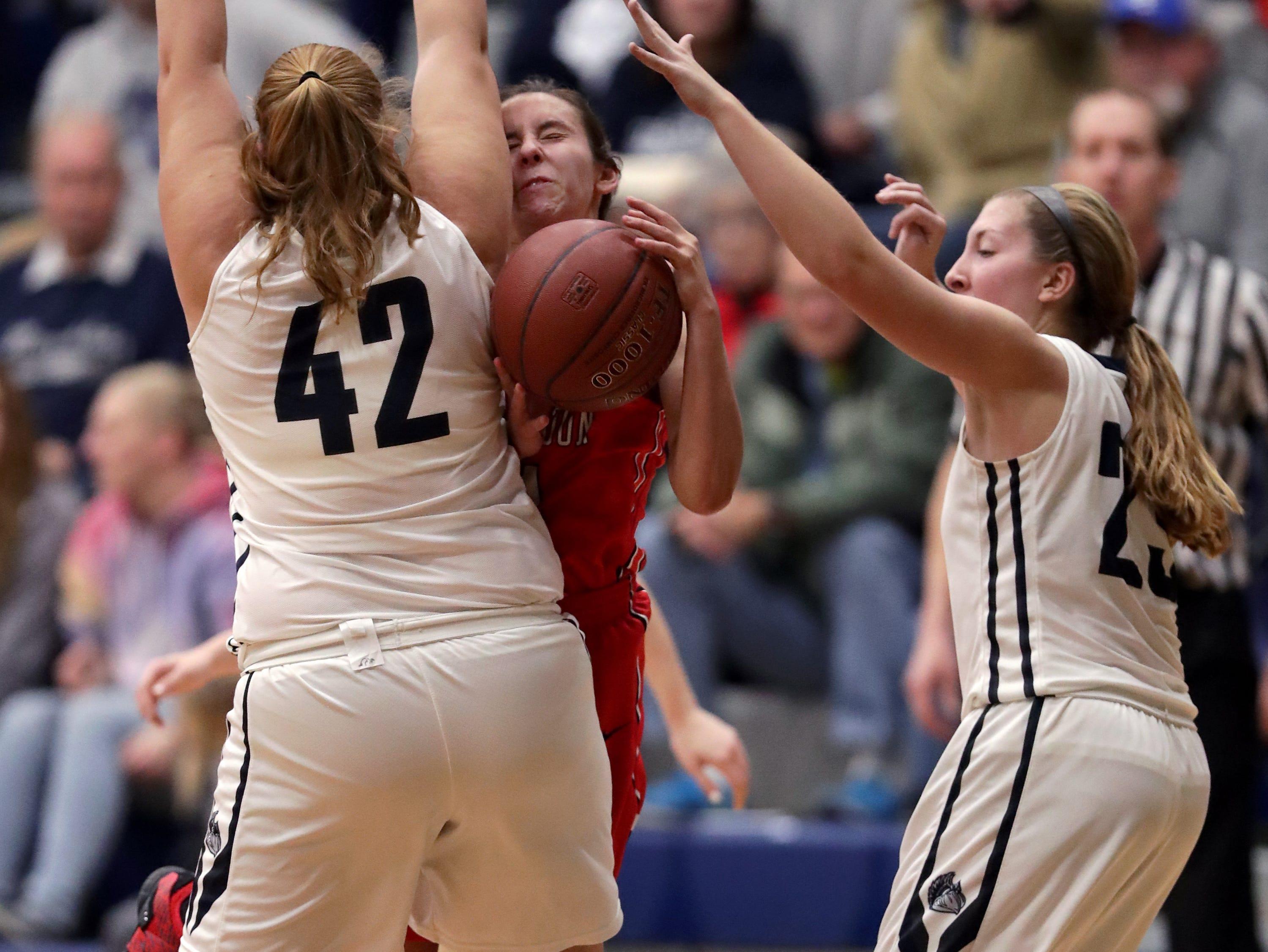 New London High School's #24 Samantha Pfefferle against Menasha High School's #42 Alyssa Rieder and #23 Alexa Yost during their girls basketball game on Friday, December 14, 2018, in Menasha, Wis.Wm. Glasheen/USA TODAY NETWORK-Wisconsin.