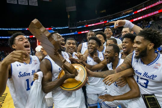 Seton Hall celebrate with trophy the received for beating Rutgers 72-66. Rutgers Mens Basketball vs Seton Hall at the Prudential Center in Newark, NJ on December 15, 2018.