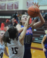 Cooper's Brianna Garcia (10) has the ball knocked away by Eula's Susie Luckow while driving to the basket. Eula beat the Lady Cougars 46-38 in the nondistrict game Friday, Dec. 14, 2018, at Eula.