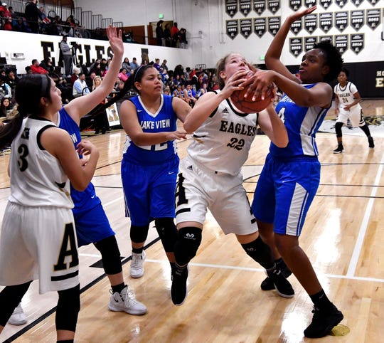 Abilene High's Kelly Boyland is momentarily blocked from making the shot during the Eagles game against Lake View High Friday Dec. 14, 2018. Final score was 54-22, Abilene High.