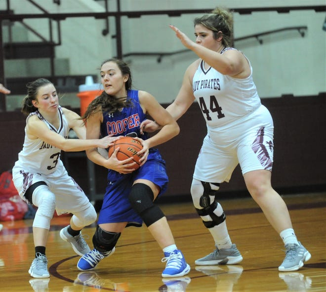 Cooper's Brianna Garcia, center, tries to fend off Eula's Rain Skelton, left, and Abbey Matties. Eula beat the Lady Cougars 46-38 in the nondistrict game Friday, Dec. 14, 2018, at Eula.