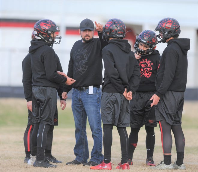Strawn defensive coordinator Jose Cervantes instructs his players during practice Friday. Their Greyhounds seek to defend their Class 1A DII championship this week against Follett.