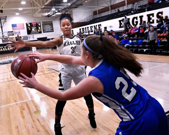Abilene High's Tevyan Jones tries to block Lake View High's Mikaila Wagner from passing the ball during Friday's basketball game at the Eagle Gym Dec. 14, 2018. Final score was 54-22, Abilene High.