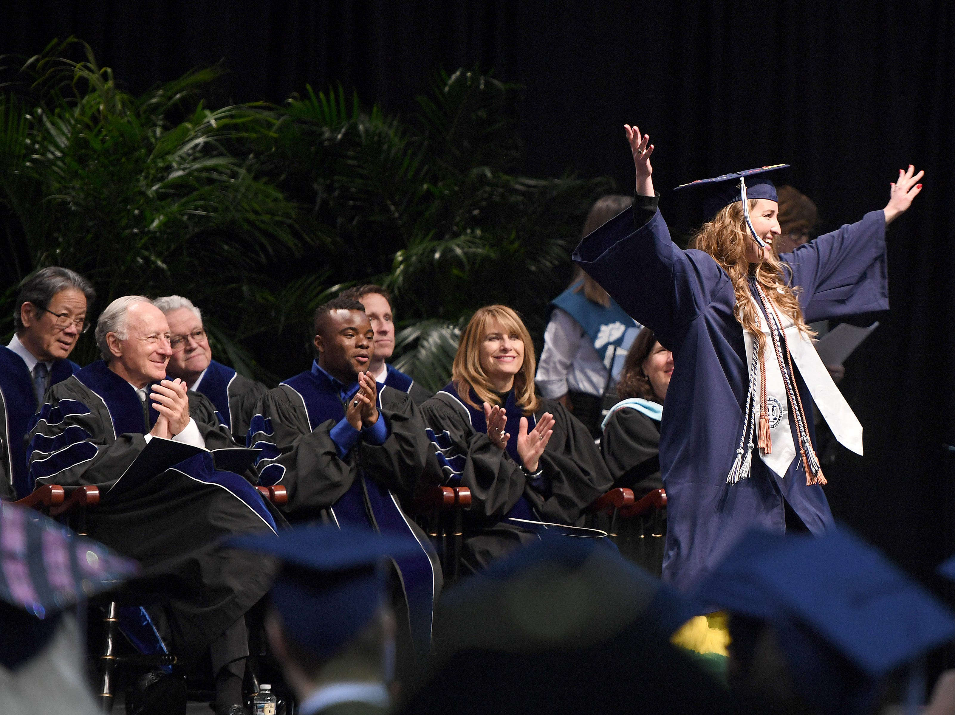 Amber Owens does a twirl on the stage during the UNC Asheville winter commencement ceremony at Kimmel Arena on Dec. 14, 2018.