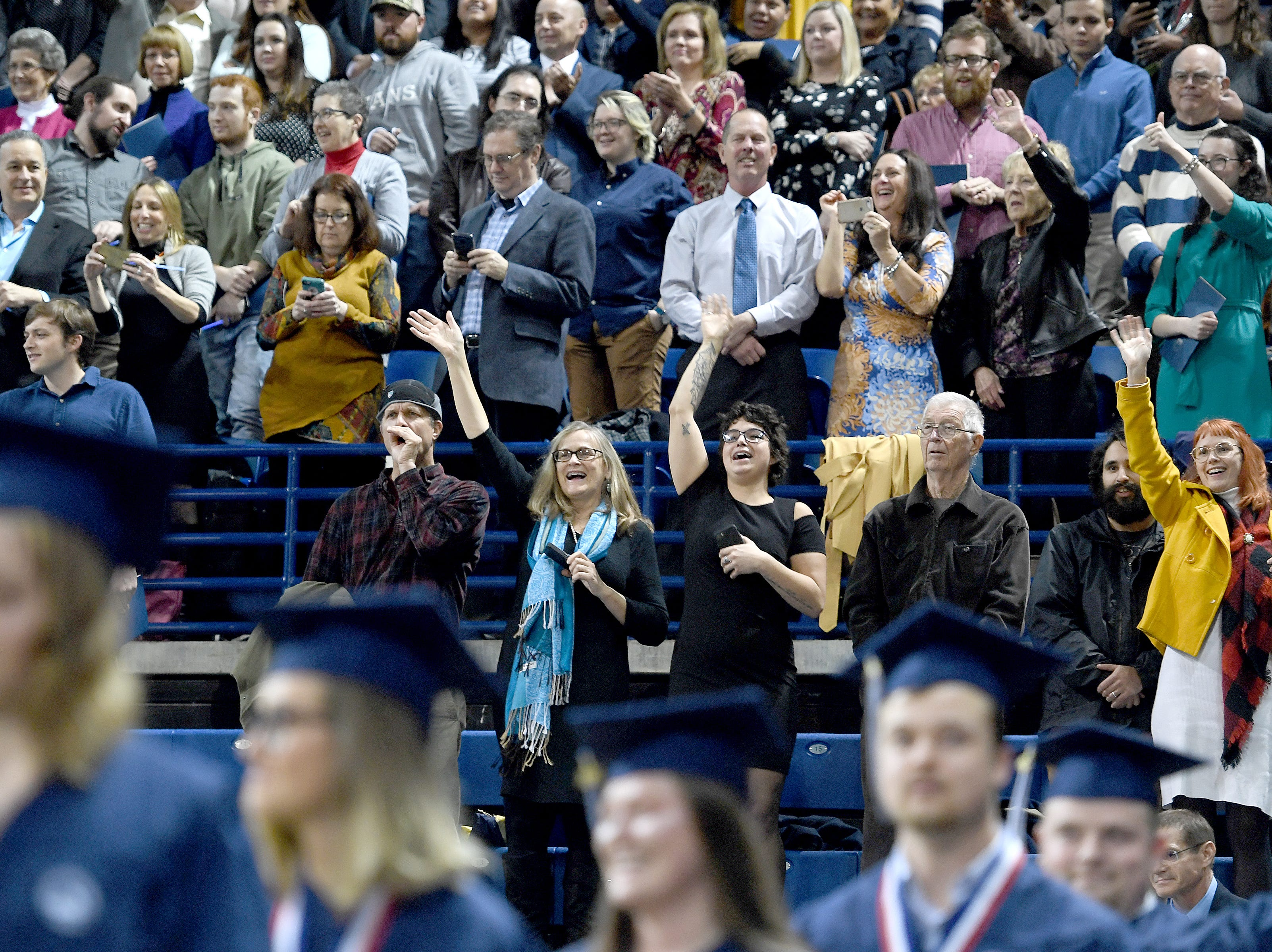 The crowd cheers as the graduates enter the arena for the UNC Asheville winter commencements at Kimmel Arena on Dec. 14, 2018.