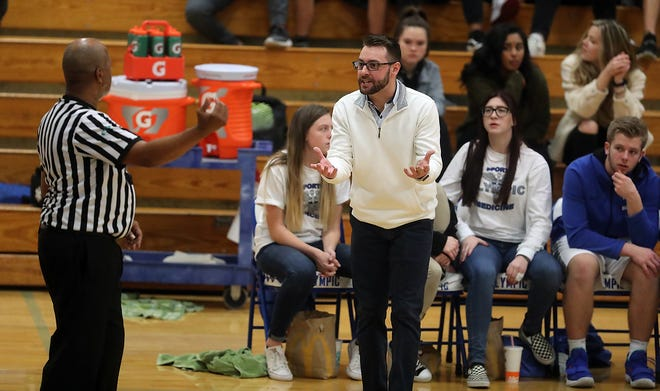 Olympic boys basketball coach Jon O'Connor and the Trojans are off to a slow start, winning two of seven games to open the 2018-19 season.