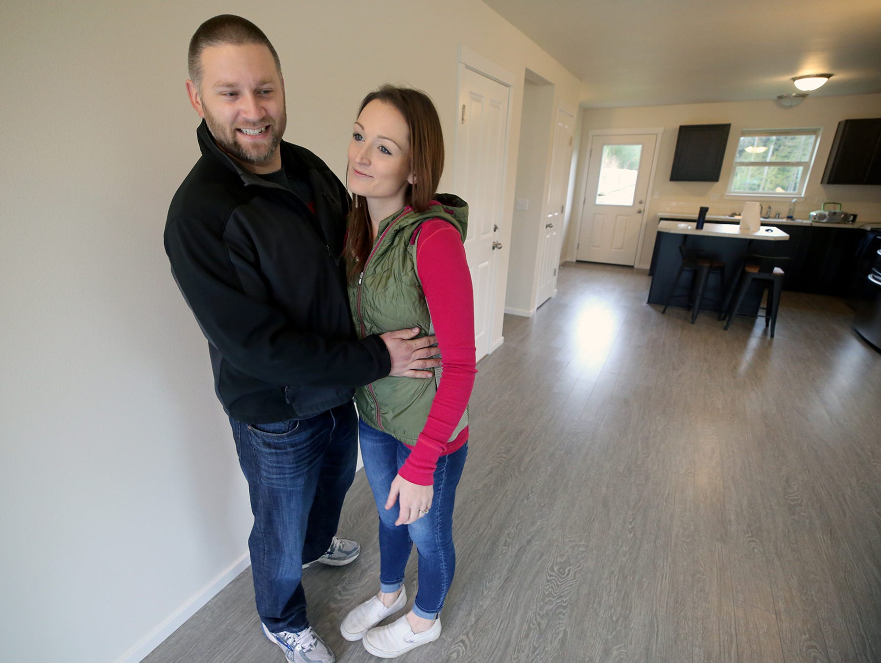 Brandon and Jessica Johnson inside their new home at the opening ceremony of the Maple Lane Group One Kitsap Housing development in Kington on Friday, December 14, 2018.