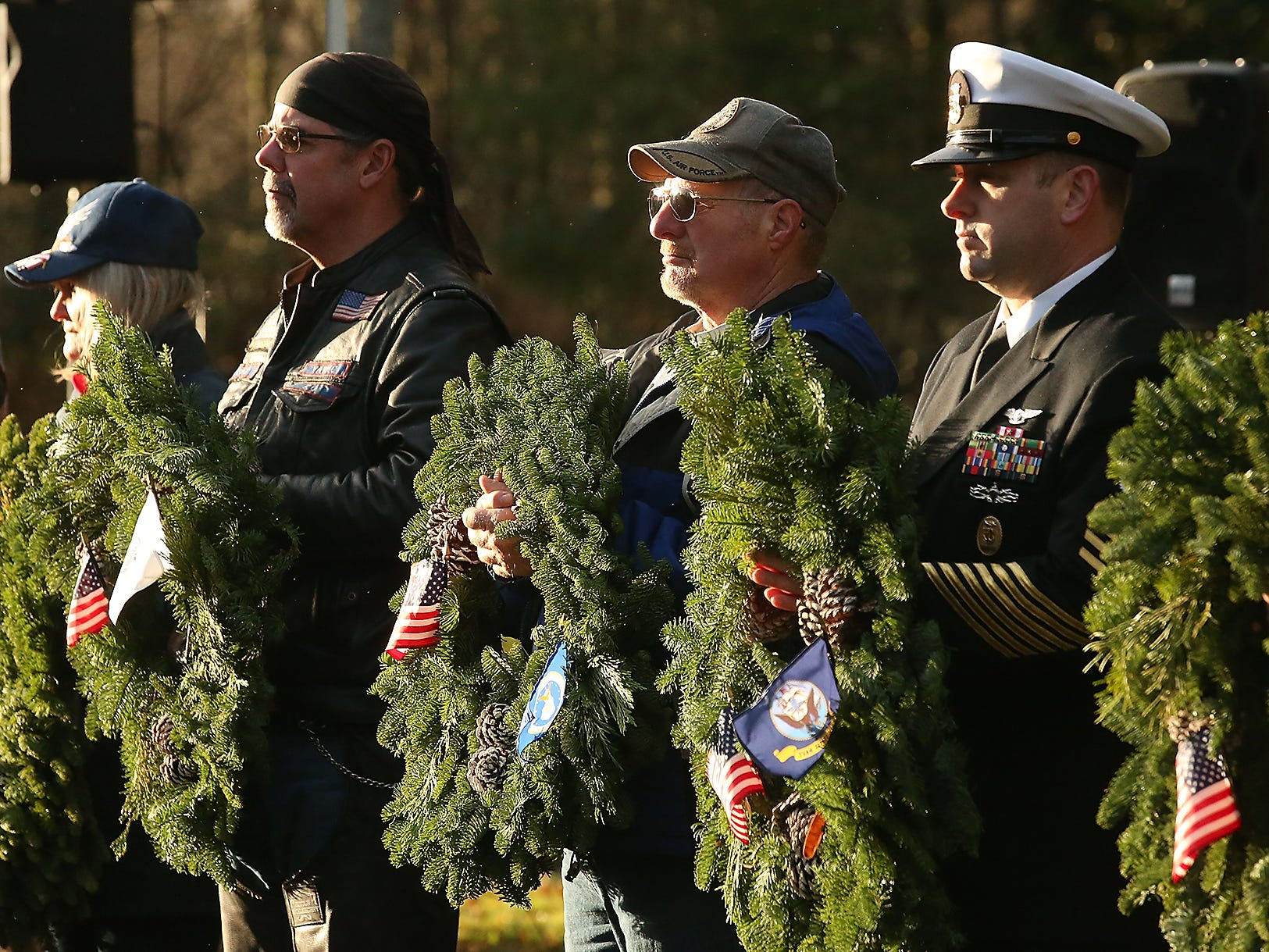 Volunteers placed 2143 wreaths during the Wreaths Across America event at the Washington Veterans Home Cemetery in Port Orchard on Saturday, December 15, 2018.