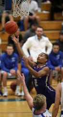 North Kitsap's Kobe McMillian and the Vikings are battling with Port Angeles for the top spot in the Olympic League 2A boys standings.