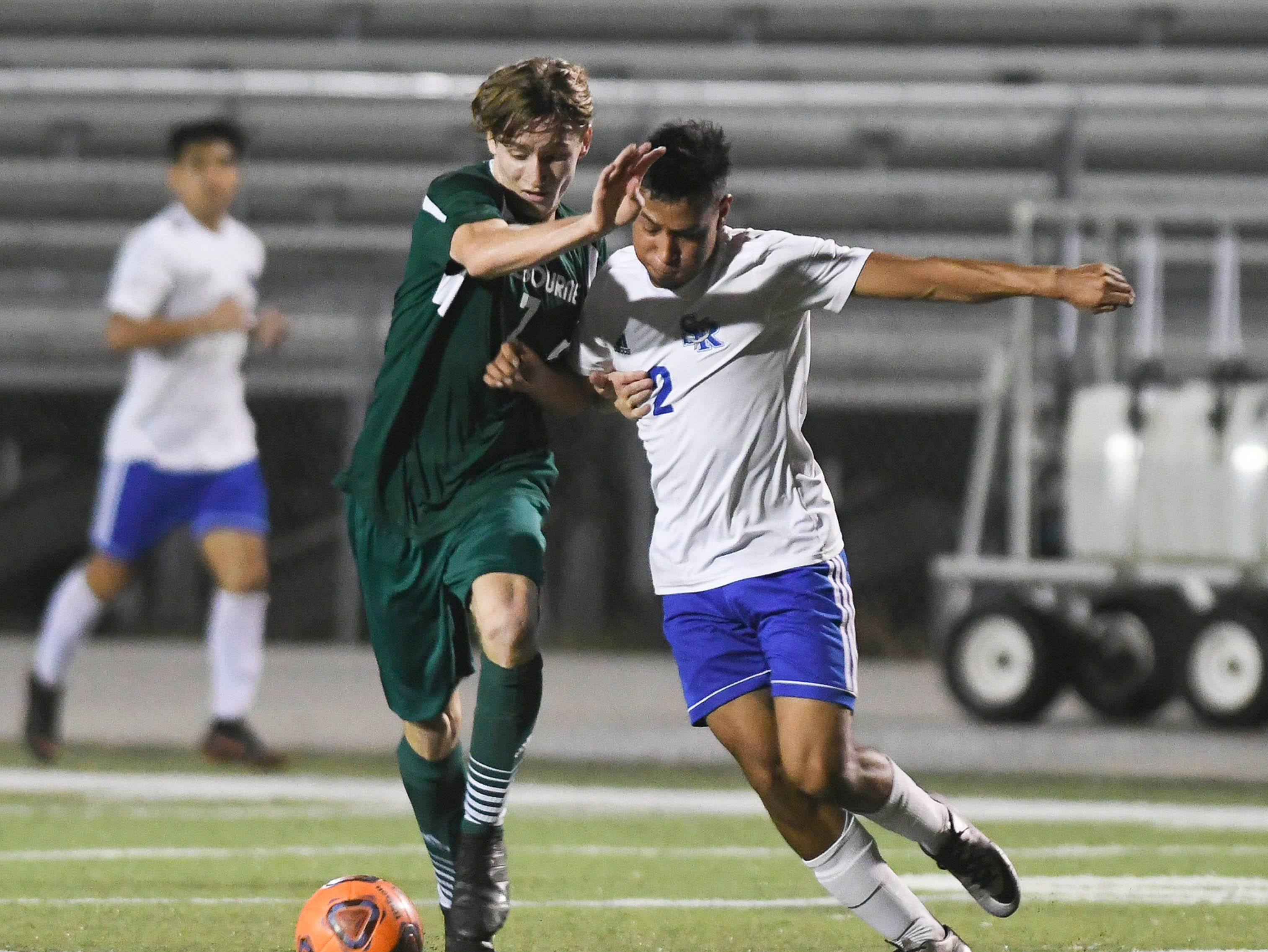 Melbourne's Marcos Gonzalez battles with Max Marcos of Sebastian River during Friday's game in Melbourne.