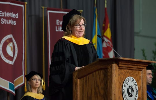 Commencement speaker Mary Beth Koelbl, manager of the propulsion systems department at NASA's Marshall Space Center, spoke to the attending 427 students about four strategic goals at NASA that are captured by four words: Explore, Develop, Enable and Discover.