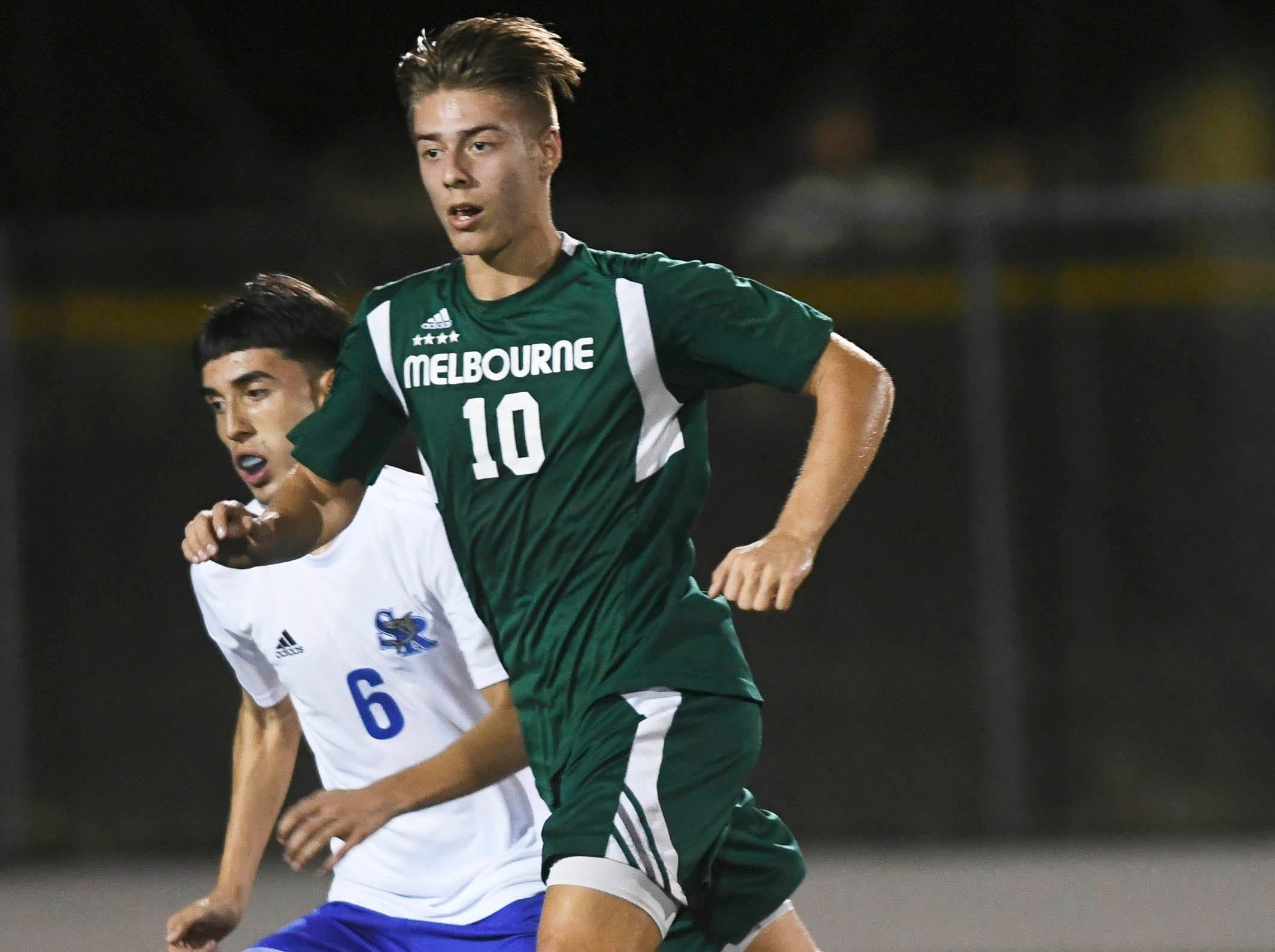 Ivan Moreno of Sebastian River and Aden O'Hara of Melbourne chase the ball during Friday's game in Melbourne.