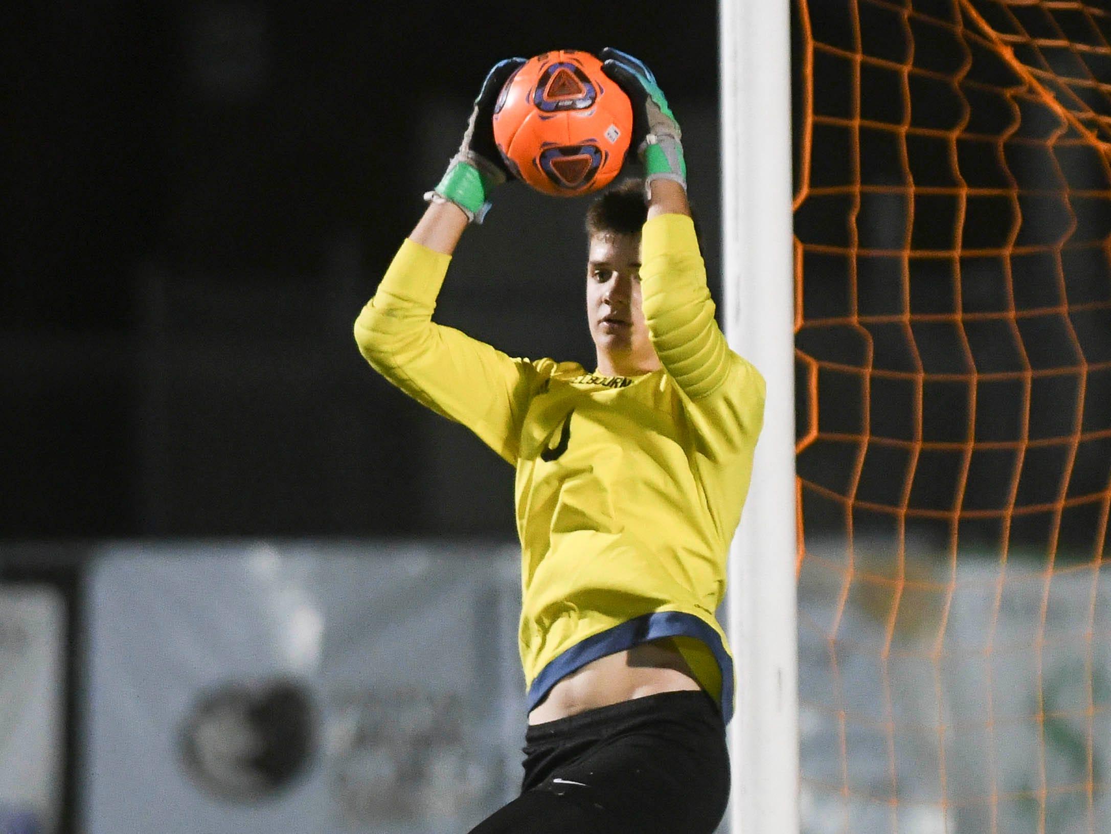 Melbourne goalkeeper Zach Browne stops a Sebastian River shot on goal during Friday's game in Melbourne.