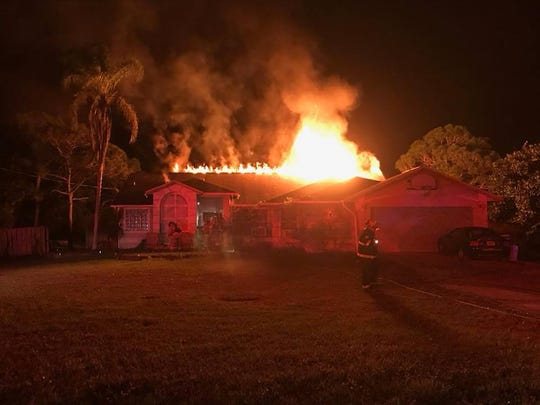 The Malabar Fire Department posted this photograph of the Conklin family's burning house on Facebook on Dec. 14, 2018.