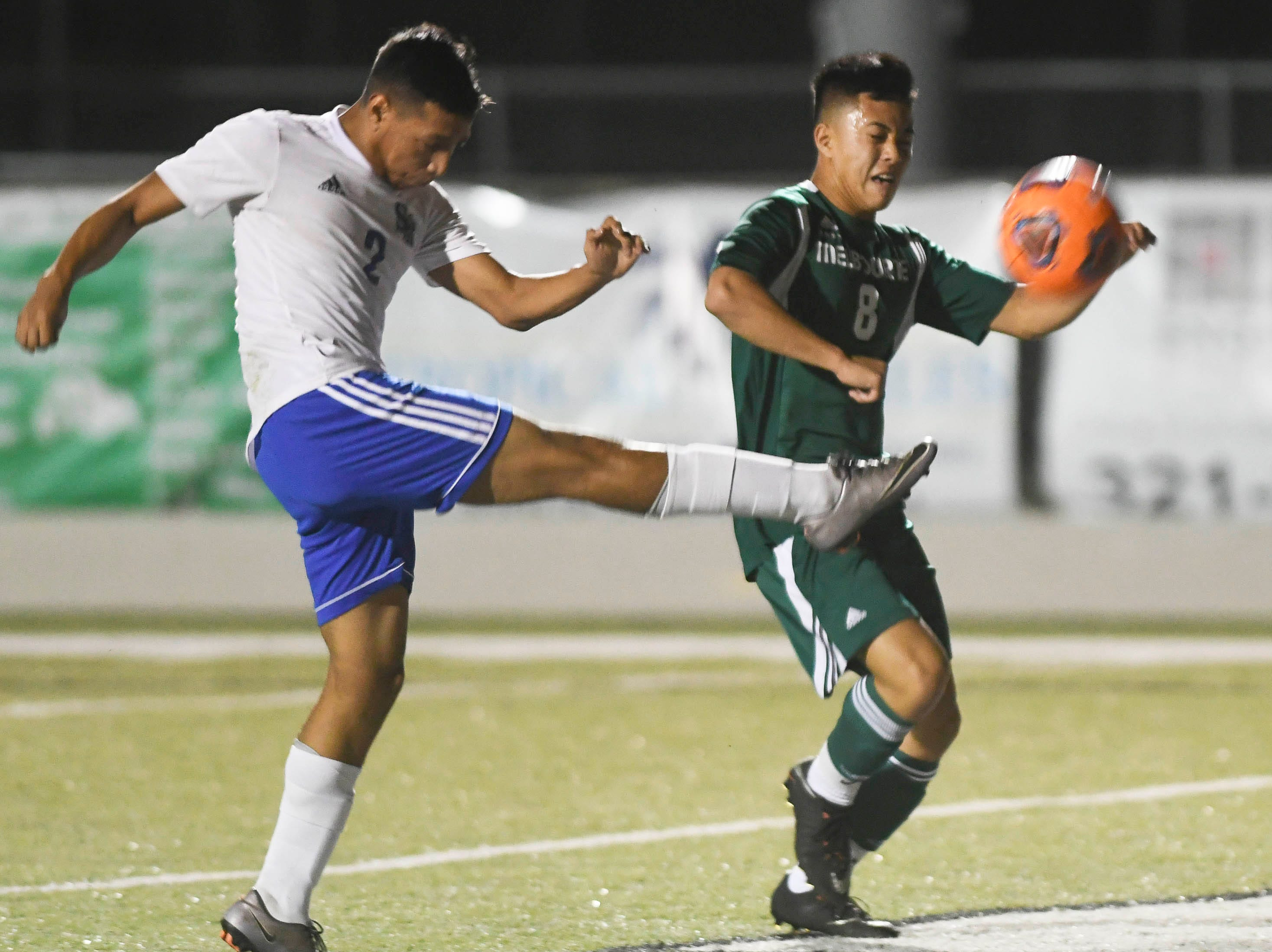 Gilberto Garcia of Sebastian River directs the ball away from Joey Dinh of Melbourne during Friday's game in Melbourne.