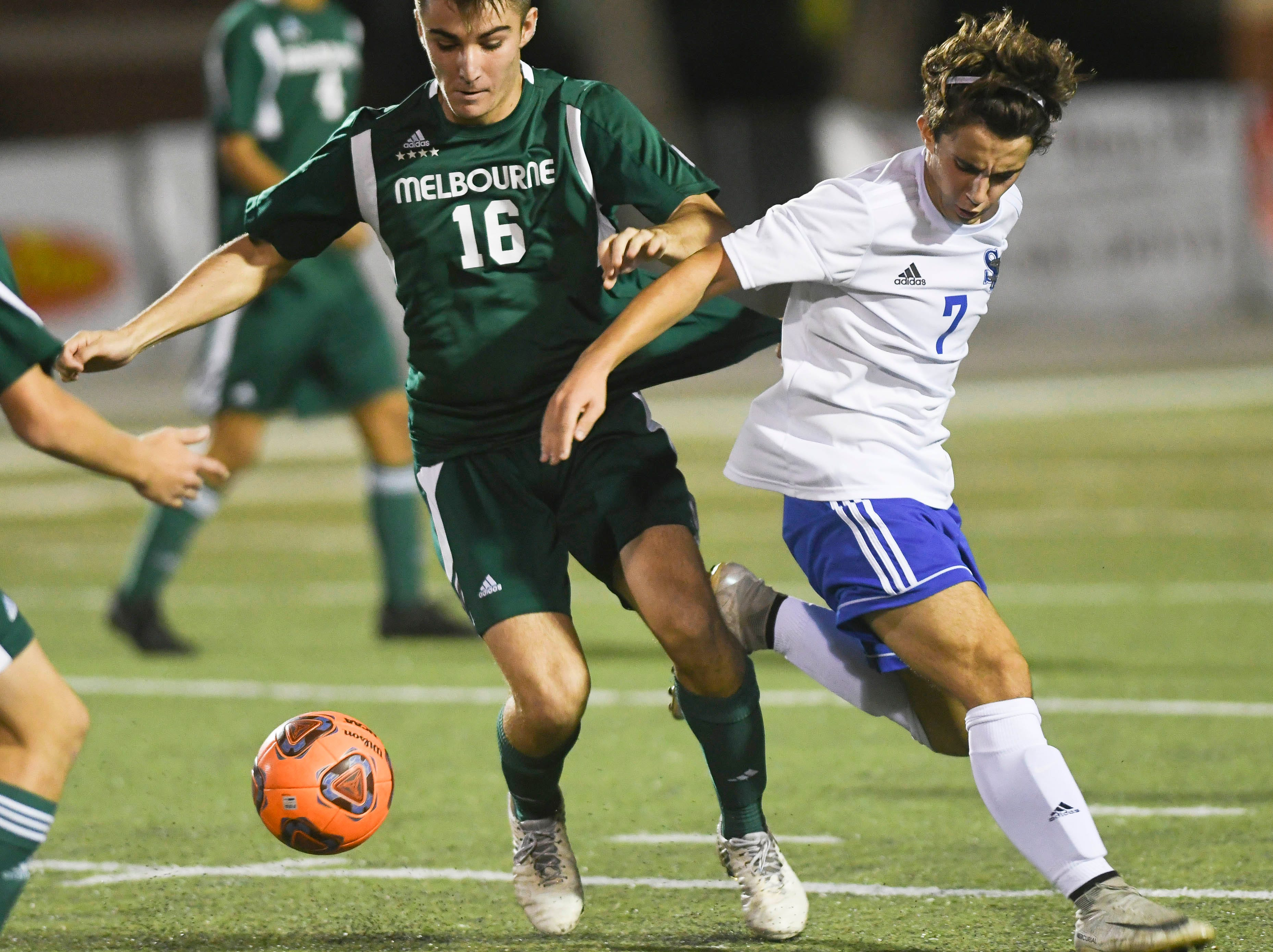 Melbourne's Calvin MacDonald and Marcos Gonzalez of Sebastian River battle for control of the ball during Friday's game in Melbourne.