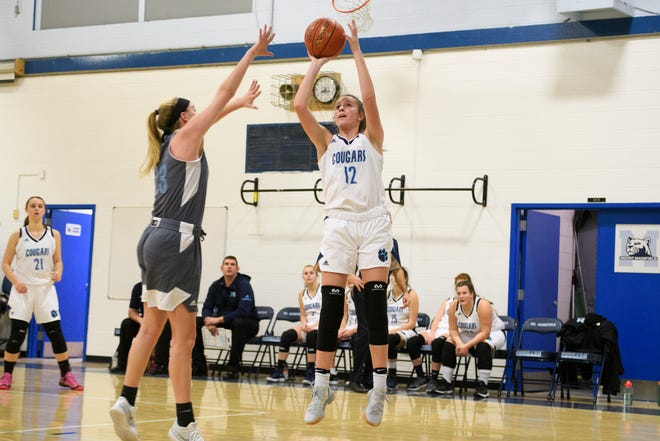 MMU's Sophia Farrell (12) shoots the ball during the girls basketball game between the South Burlington Wolves and the Mount Mansfield Cougars at MMU High School on Friday night December 14, 2018 in Jericho.