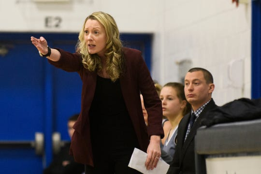 South Burlington head coach Stephanie Beck-Bryant talks to the team on the court during the girls basketball game between the South Burlington Wolves and the Mount Mansfield Cougars at MMU High School last winter.