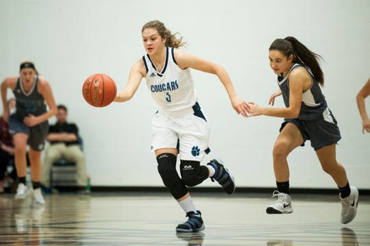 MMU's Caitlyn Luitjens (3) runs down the court with the ball during the girls basketball game between the South Burlington Wolves and the Mount Mansfield Cougars at MMU High School on Friday night December 14, 2018 in Jericho.