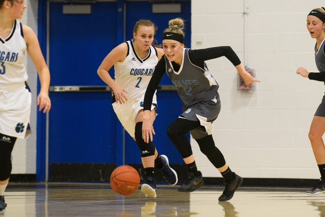 South Burlington's Colby Casey (12) runs down the court with the ball during the girls basketball game between the South Burlington Wolves and the Mount Mansfield Cougars at MMU High School on Friday night December 14, 2018 in Jericho.