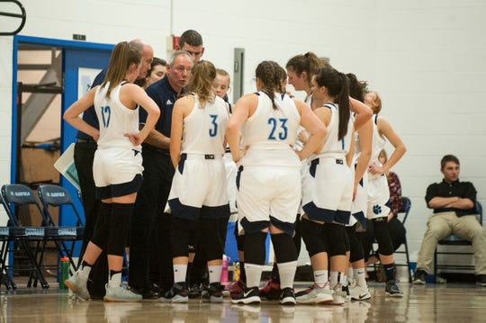 MMU head coach Mark Pfaff talks to the team during a time out in the girls basketball game between the South Burlington Wolves and the Mount Mansfield Cougars at MMU High School on Friday night December 14, 2018 in Jericho.