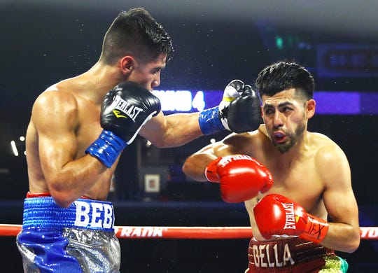 Mexico's Ruben Vega connects with a left hand as Oscar Mojica tries to duck during their 6-round Bantamweight fight on Friday, Dec. 14, 2018 at the American Bank Center.