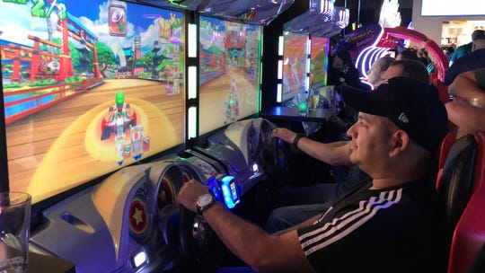 More than 400 people were the first to enter the new Dave & Buster's inside La Palmera mall for a private VIP event Thursday, Dec. 13, 2018.