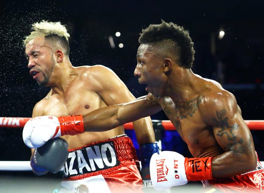 Joshua Greer lands a punch on Daniel Lozano during their Bantamweight bout on Friday, Dec. 14, 2018 at the American Bank Center.