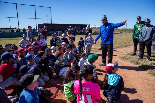 Jose Trevino, a Texas Rangers minor leaguer, talks with participants of the baseball camp and annual Trevino Toy Drive at John Paul II High School on Saturday, December 15, 2018.