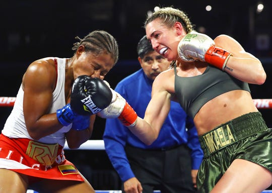 Mikaela Mayer lands a right hand punch on Calixta Salgado during the fight on Friday, Dec. 14, 2018 at the American Bank Center.