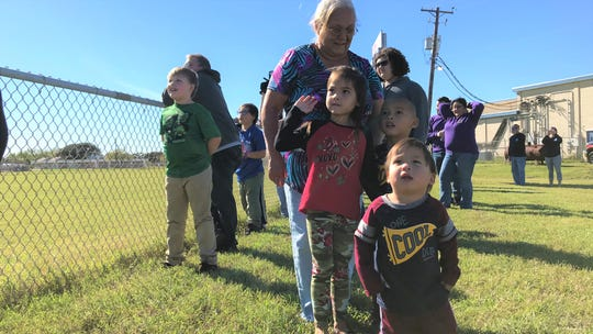 Children look at Blue Santa at the Boys and Girls Club of the Coastal Bend on Saturday, Dec. 15, 2018. Santa brought dozens of toys for the children at the club.