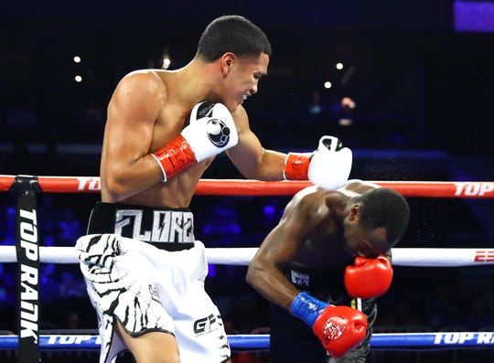 Gabriel Flores tries to land a left hand punch on Edward Kakembo during their Lightweight bout on Friday, Dec. 14, 2018 at the American Bank Center.