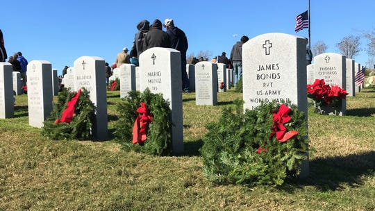 Wreaths lay on the graves of military veterans during Wreaths Across America at the Coastal Bend State Veterans Cemetery on Saturday, Dec. 15, 2018.