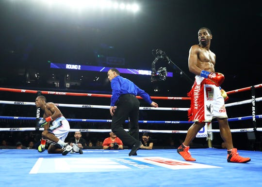 Jamel Herring walks away after knocking down Adeilson Dos Santos during their 8-round Lightweight bout on Friday, Dec. 14, 2018 at the American Bank Center.