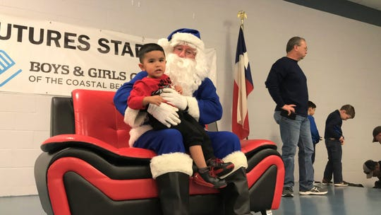 George Ramos, 2, sits with Blue Santa at the Boys and Girls Club of the Coastal Bend on Saturday, Dec. 15, 2018.