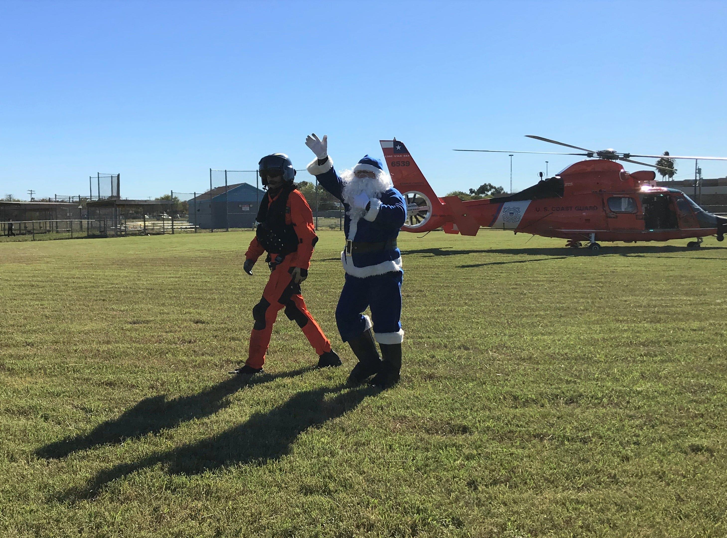 Blue Santa arrives in a U.S. Coast Guard helicopter to the Boys and Girls Club of the Coastal Bend on Saturday, Dec. 15, 2018. Santa brought dozens of toys for the children at the club.
