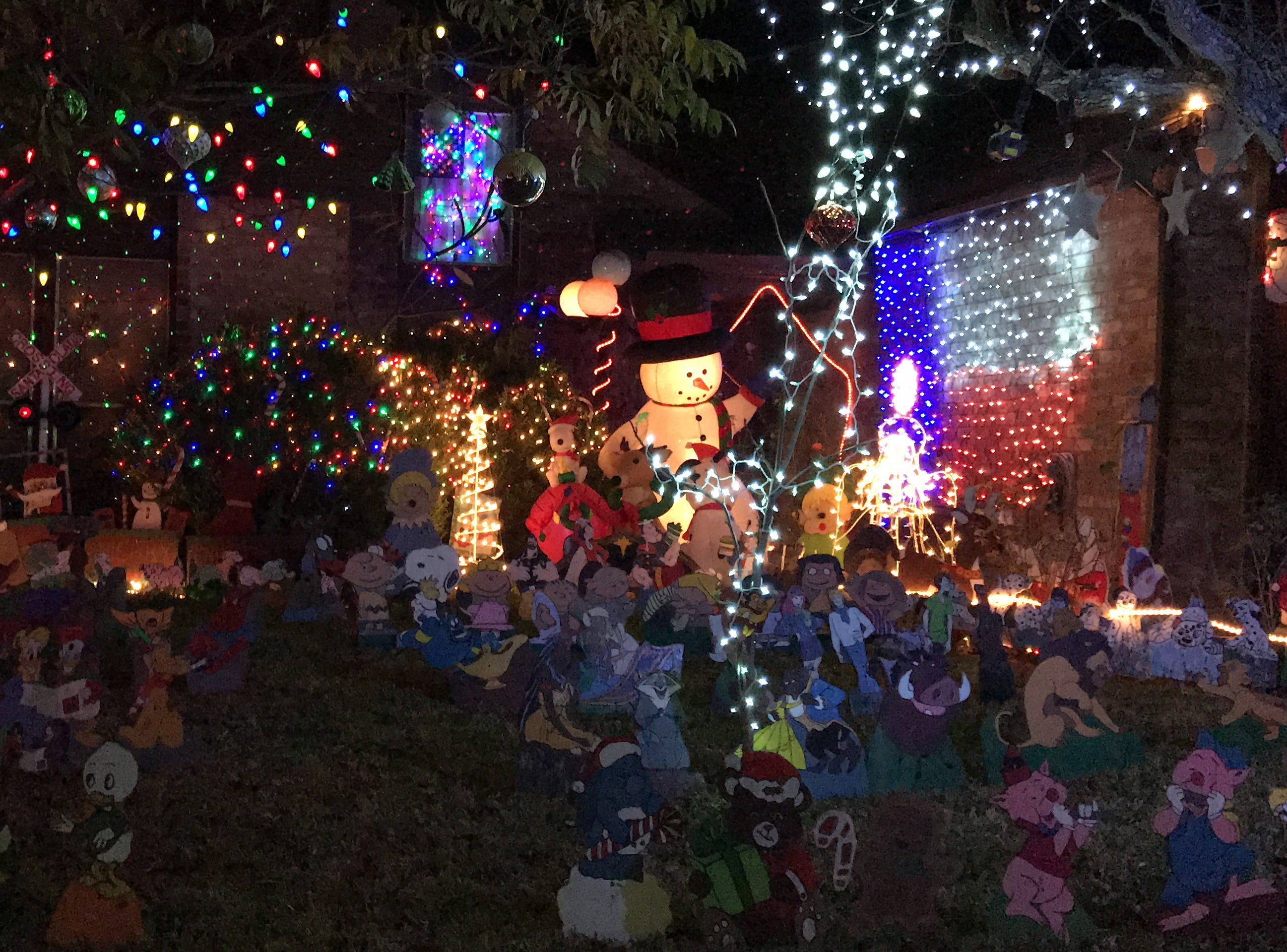 This Corpus Christi home on 4709 Willowick Drive features dozens of hand-crafted cartoon characters in the front lawn.